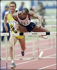 Colin Jackson storms to victory in the final of the 1999 World Indoor Championships