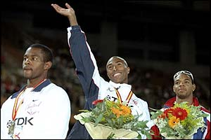 Colin Jackson celebrates his gold medal at the 1999 World Championships