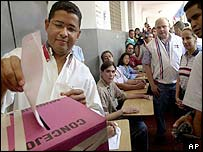 Salvadoran President Francisco Flores casts his vote