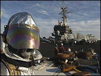 Airman on flight deck of US carrier Kitty Hawk