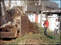 Rachel Corrie (orange jacket) confronts Israeli army bulldozer on day she died