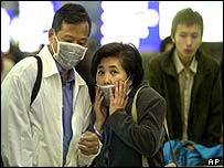Passengers wearing masks in Hong Kong in airport