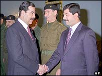 Saddam Hussein (left) and his younger son Qusay in 1997