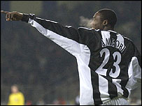 Newcastle striker Shola Amoebi celebrates one of his two goals against Bayer Leverkusen