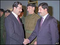 Saddam Hussein and his son Qusay