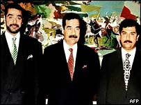 Saddam Hussein and his sons Uday (L) and Qusay