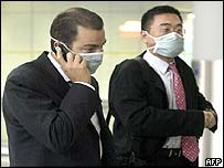 Businessmen wearing protective masks in Hong Kong