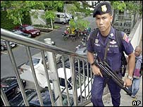 A Thai police officer patrols on the flyover outside the U.S. embassy in Bangkok