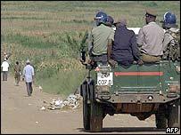 Riot police patrol in Harare