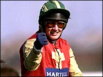 Paul Carberry celebrates victory in the 1999 Grand National