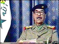 Saddam Hussein during television address