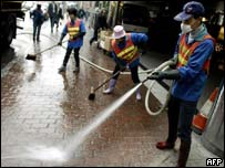 Floors are hosed down at the Metropole Hotel, Hong Kong