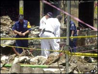 Police pick through the debris of the Bali bombing,