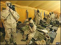 US and British troops preparing to take shelter during Iraqi missile threat in Kuwaiti