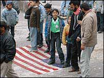 US flag spread on ground of schoolyard for protesters to walk over