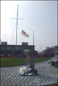 Flag and flowers tribute. Picture taken by Rosie Dunkley