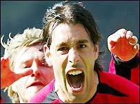 Man Utd's Ruud van Nistelrooy celebrates after scoring yet another goal