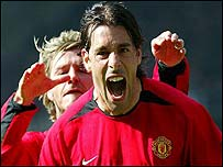 David Beckham congratulates Ruud van Nistelrooy on his Old Trafford hat-trick