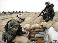 US marines check overrun Iraqi position for booby traps in Umm Qasr
