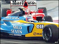 Jarno Trulli is hit by Michael Schumacher at the second corner in Malaysia