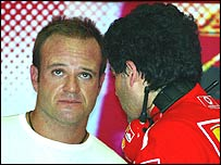 Rubens Barrichello talks to a Ferrari engineer