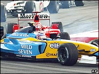 Michael Schumacher T-bones Jarno Trulli at the start of the Malaysian Grand Prix