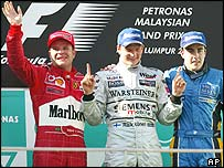 Rubens Barrichello, Kimi Raikkonen and Fernando Alonso on the podium at the Malaysian Grand Prix