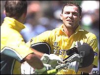 Damien Martyn is congratulated by Ricky Ponting