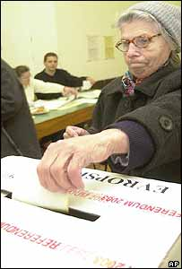A Slovene woman casts her vote
