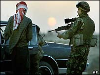 British soldier searches a man near Basra