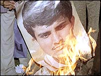 A poster of Sourav Ganguly is burnt after India's World Cup final defeat