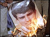 A poster of Sourav Ganguly being burned in Delhi