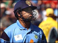 Sachin Tendulkar walks off after he was dismissed in the World Cup final
