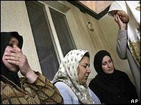 Women at al-Nouman hospital wait for news of wounded relatives