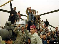 Iraqis with the captured Apache