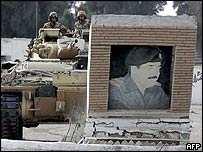 Tank demolishes Saddam Hussein monument outside Basra