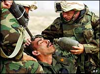 US troops give an injured Iraqi soldier water