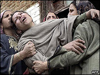 Mourner comforted by relatives in Nadimarg, the site of the massacre