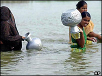 Bangladeshi women collect water