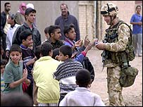 Coalition soldier with kids in Umm Qasr