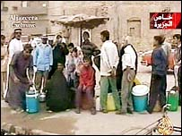 People queue for water in Basra