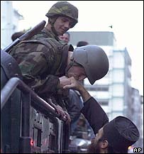 Special police kiss hand of Orthodox priest in October 2000