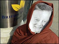Man in Kenneth Clarke mask