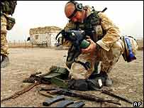 Soldier examines Iraqi gas mask   AP