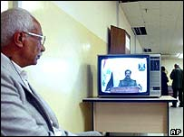 Man watching Iraqi television at the Information Ministry