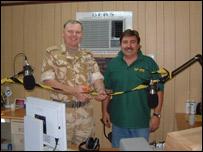 Brigadier Shawn Cowlam helps DJ Chris Pratt open the BFBS station in Kuwait