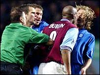Dion Dublin appears to head butts Robbie Savage