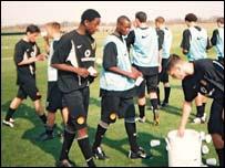 Yobe and Nkausu (middle) with Man Utd's U-19 team