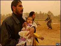 An Iraqi family is evacuated by US Marines in the city of Nasiriya