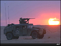 A humvee crosses the southern Iraqi desert